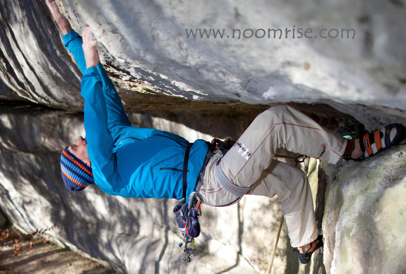 Patrick Matros during the first ascent of Archon, a trad 8b in the Frankenjura, Germany. Photo www.noomrise.com, Raimund Matros