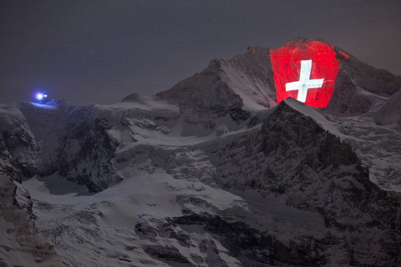 The North Face of the Jungfrau (4158m) in Switzerland, illuminated to celebrate 100 years Jungfraubahn., Jungfraubahnen/martinkeller.ch
