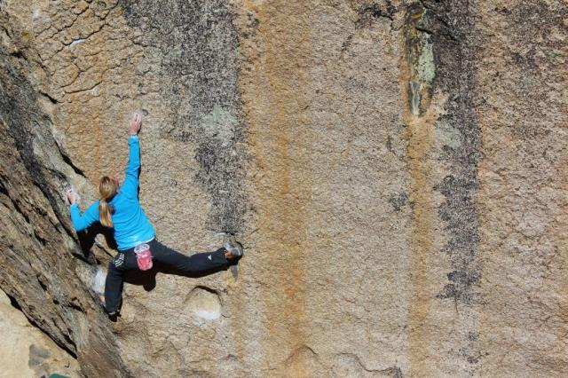 Katharina Saurwein boudlering at the Buttermilks, Bishop, USA, Jorg Verhoeven