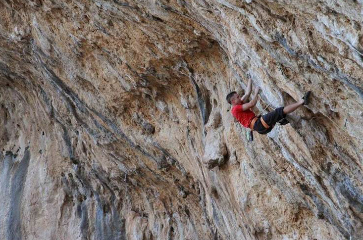 Neil Gresham climbing Tyrant 8a+ in the E.T. Cave, Kalymnos, Simon Kincaid