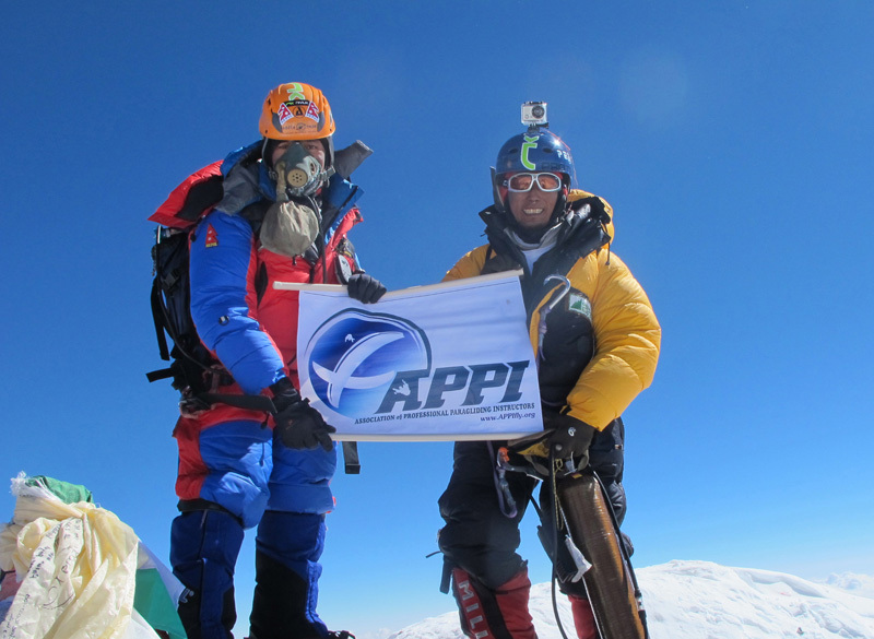 Sano Babu Sunuwar and Lakpa Tsheri Sherpa arrived at the summit of Mount Everest (29,035 feet) on May 21, 2011. This was Lapka's fourth summit and Babu's first. They proudly hold a banner from Babu's workplace, the Association of Paragliding Pilots and Instructors., © Sano Babu Sunuwar