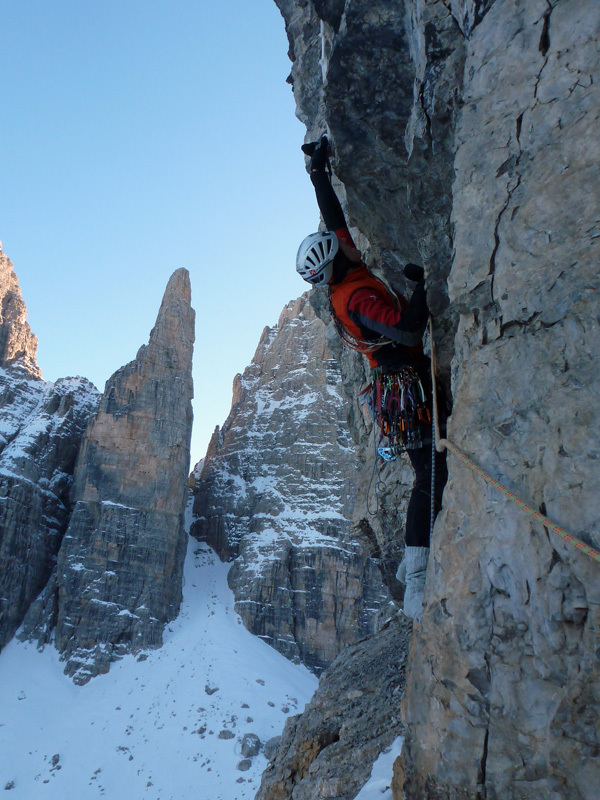 Rolando Larcher and, in the background, Campanile Basso, Brenta Dolomites., archivio Larcher, Giupponi e Leoni