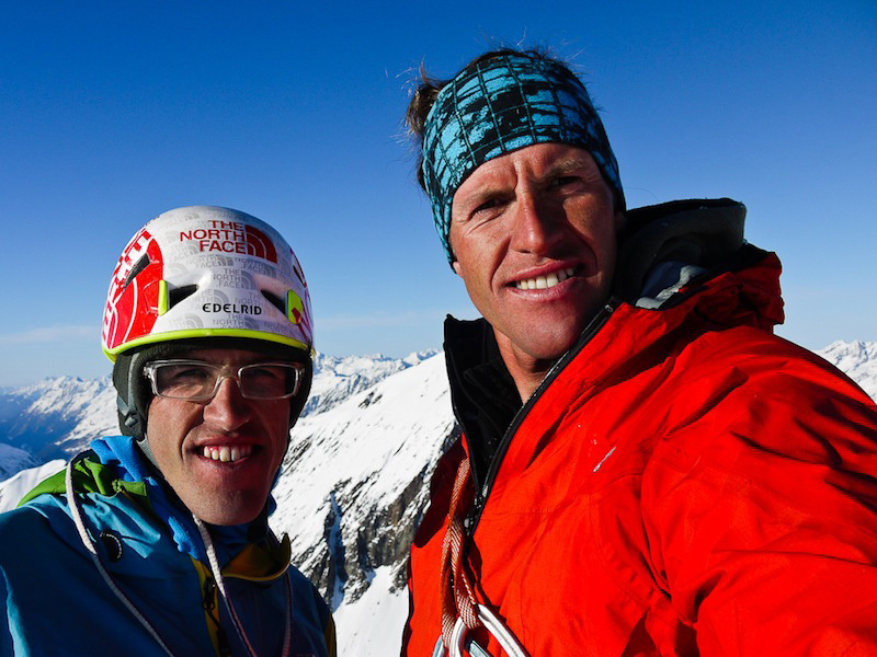 Hansjörg Auer & Matthias Auer on the summit of Kirchkogel in Austria., Hannes Mair / Alpsolut Films