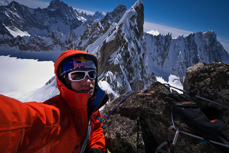 David Lama on the summit of Pointe Raphel Borgis du Pré de Bar after having climbed the route Les Barbares., David Lama