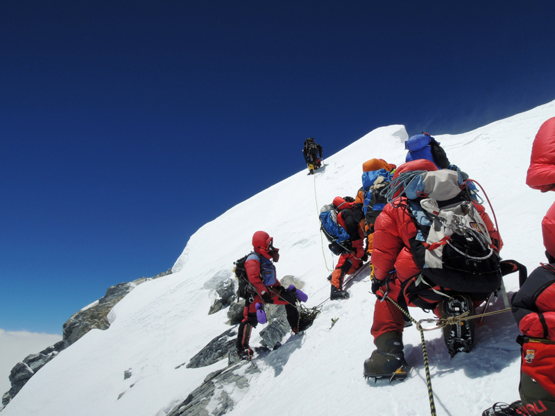 Sherpa fixing ropes beneath the summit of Everest on 18/05/2012, Ueli Steck