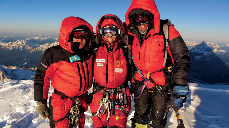 Maxut Zhumayev (left) of Kazakhstan, Gerlinde Kaltenbrunner, originally from Austria, and Vassiliy Pivtsov of Kazakhstan just after reaching the top of K2, the world's second-highest mountain, on Aug. 23, 2011. Each of the three alpinists has summited all of Earth's 14 major peaks without using supplementary oxygen. Kaltenbrunner was named National Geographic Explorer of the Year for her achievement in a ceremony in Washington, DC on June 14, 2012., © Dariusz Załuski / National Geographic