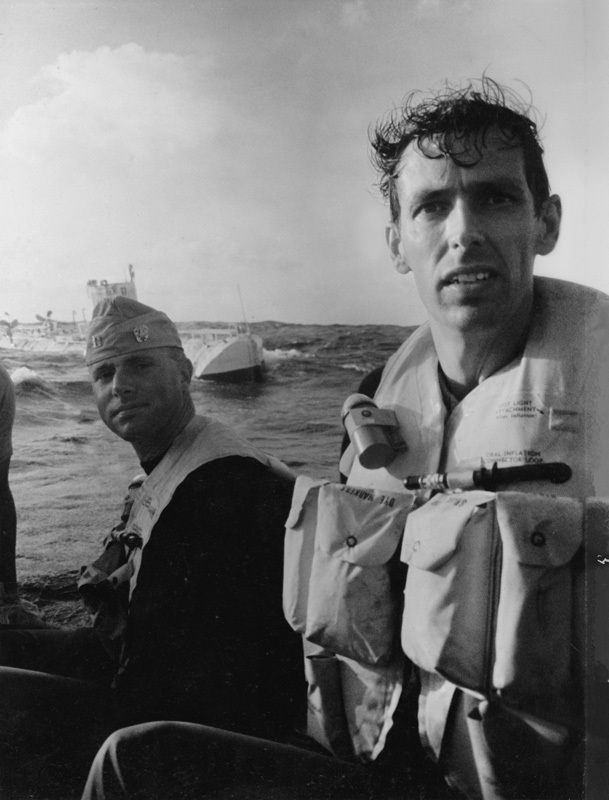 After their successful nine-hour dive in January 1960 to the bottom of the Pacific Ocean's Mariana Trench, Don Walsh and Jacques Piccard emerge from the bathyscaphe Trieste. Walsh and Piccard were the first to reach the trench's lowest point, Challenger Deep, some 35,800 feet below the ocean surface.  Piccard, who died in 2008, was posthumously awarded the Hubbard Medal, the National Geographic highest honor, at a ceremony in Washington, D.C., on June 14, 2012. , © Thomas J. Abercrombie / National Geographic