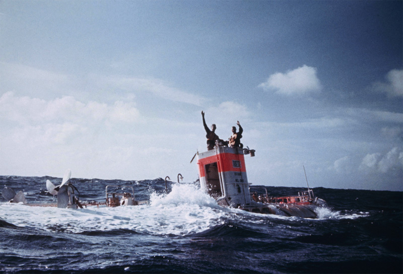 Jacques Piccard and Don Walsh emerge from the bathyscaphe Trieste following their successful descent to the bottom of the Pacific Ocean's Mariana Trench in January 1960. Walsh and Piccard were the first people to reach the trench's — and Earth's — lowest point, Challenger Deep, some 35,800 feet below the ocean surface.  Piccard, who died in 2008, was posthumously awarded the Hubbard Medal, the National Geographic highest honor, at a ceremony in Washington, D.C., on June 14, 2012. , © Thomas J. Abercrombie / National Geographic