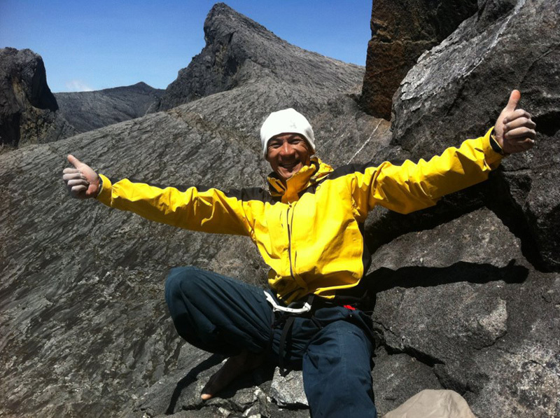 Yuji Hirayama celebrating after having freed has the 100m multi-pitch Pogulian Do Koduduo 9a, Mount Kinabalu, Borneo, Reel Rock Film Tour