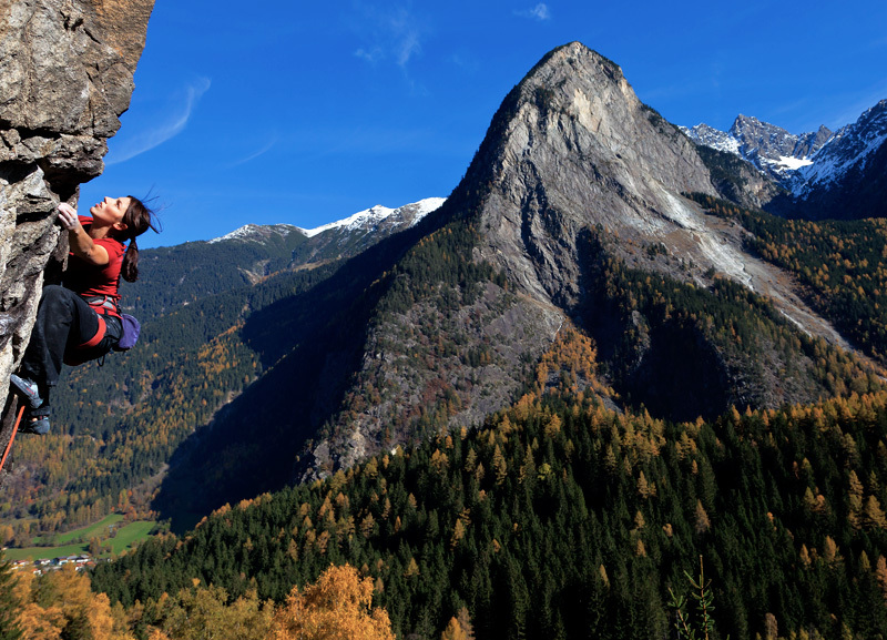 Barbara Bacher climbing at Armelenwand in Tumpen, with view onto the Acherplatte , Heiko Wilhelm