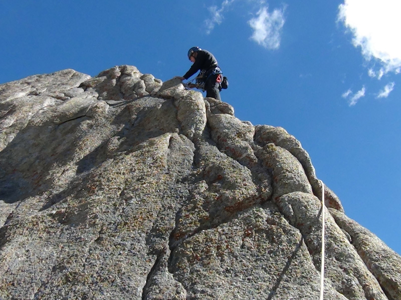 Nikolay Petkov climbing the last few meters to reach the summit of Grey Tower., Doychin Boyanov
