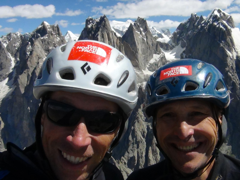 Doychin Boyanov and Nikolay Petkov on the summit of Grey Tower, clearly visible in the background the peaks Levski, Rila Tangra, Trident, Agil., Nikolay Petkov