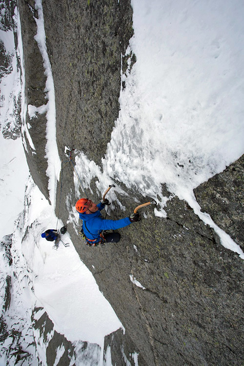 Jeff Mercier leading pitch 10 of Full Love... for dry and ice (V, 5+,M6 R, 500m): a super thin series of moves takes you to a full arm stretch to decent ice above and a sigh of relief, Jonathan Griffith