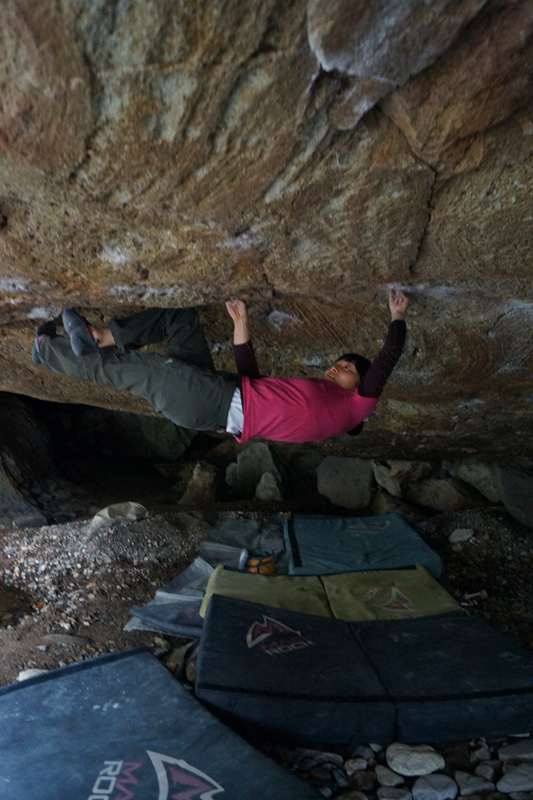 Tomoko Ogawa sending the boulder problem Catharsis (8B+) at Shiobara in Japan., © Nagao