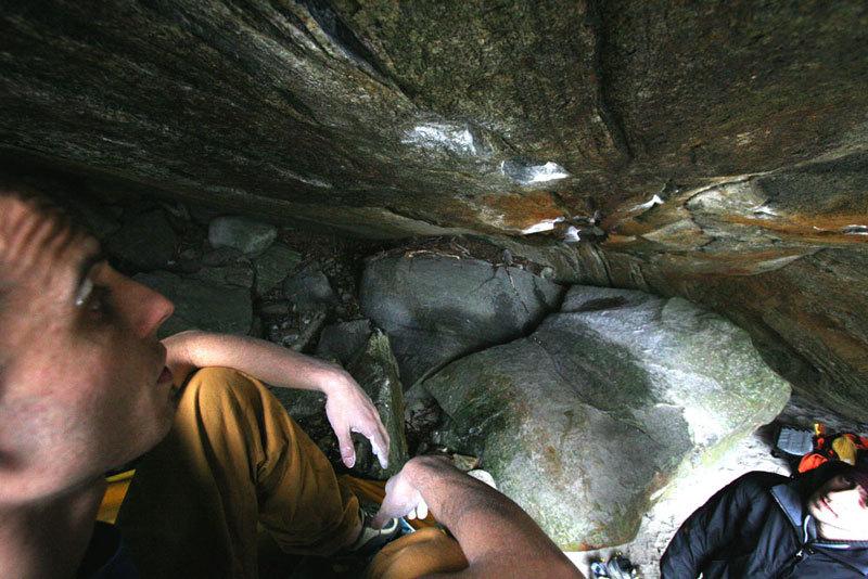Enrico Baistrocchi pensive below a boulder problem in Val Verzasca, Massimo Malpezzi