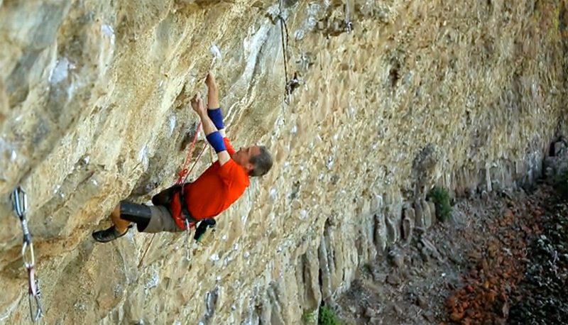 Tom Addison climbing at California's cliff Jailhouse Rock, USA., American Access Fund