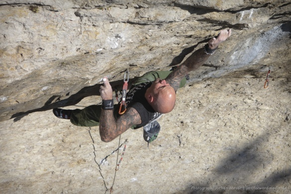 Markus Bock durign the first ascent of The 4 Horsemen 8c+, Frankenjura, Germany, Jochen Meyer