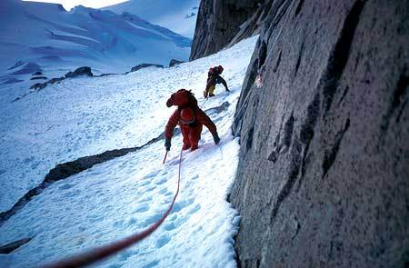 Climbing up the snow slope towards the gully., archivio Ragni Lecco