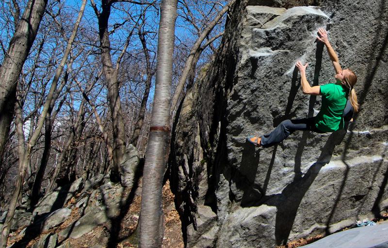 Katharina Saurwein climbing the boulder problem Komilator Pamplemousse 7C+, Ticino, Switzerland., Jorg Verhoeven