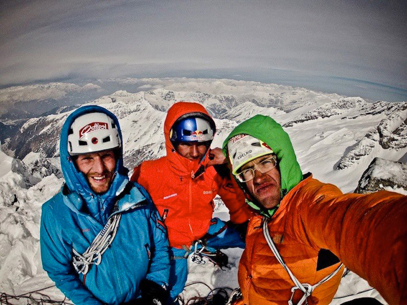 Peter Ortner, David Lama and Hansjörg Auer on the summit of Sagwand after the first winter ascent of the route Schiefer Riss.