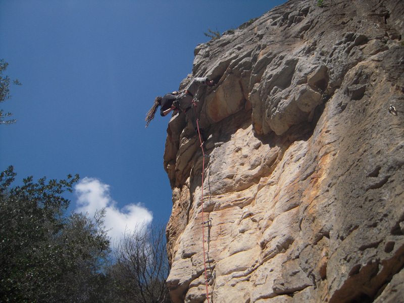 Gabriele Puccia climbing a 6b+ at the start of the crag, Max Flaccavento