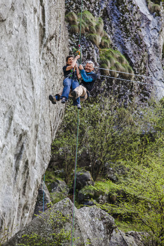 Silvia Parente abseiling into the void on Sasso Remenno, Klaus Dell'Orto
