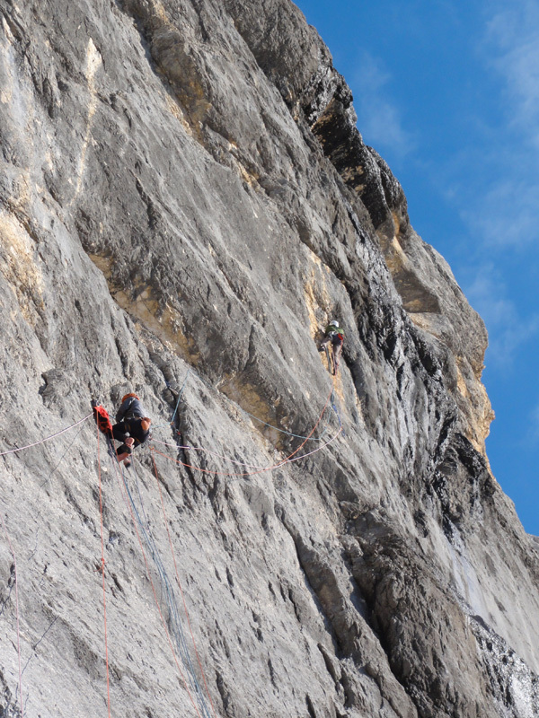 Alessandro Baù, Alessandro Beber and Nicola Tondini during the first ascent of their route Colonne d'Ercole (1200m, max IX, obl. VIII+), Punta Tissi, Civetta, Dolomites., archivio Baù, Beber, Tondini