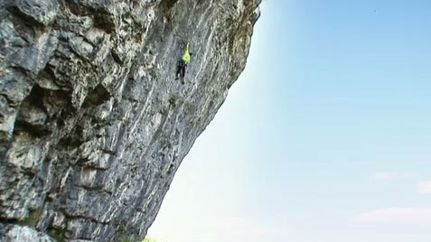 Steve McClure climbing Northern Exposure 9a+ a Kilnsey Crag, England., Alastair Lee, www.posingproductions.com