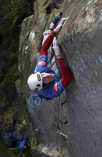James Pearson on the desperate slopy moves of The Groove E10 7b, Cratcliffe Tor, Peak District, UK. He carried out the first ascent on 02 February 2008., David Simmonite