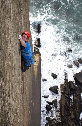 James Pearson on the first ascent of The Walk of Life, E12 7a at Dyer's Lookout, North Devon, England., David Simmonite