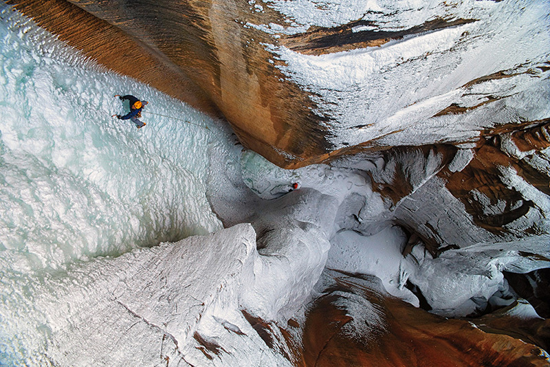 Scott Adamson climbing astounding ice in the Zion National Park, USA, Keith Ladzinski, 3 Strings Productions