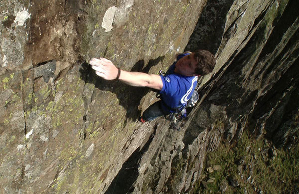 Ricky Bell goes for the ridiculous crux move on his new route at