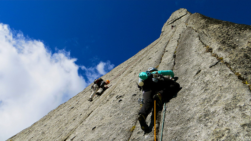 Headwall of the Lotus Flower Tower with Whitney Clark and Logan Fusso climbing. Tad Mccrea