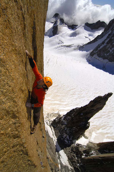 Alexander Huber in summer 2008 soloing the Swiss Route on Gran Capucin, Mont Blanc., Heinz Zak