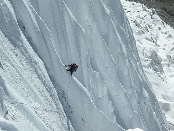 David Gottlieb crossing flutings and runnels on the headwall beneath the West Ridge, Kang Nachugo, Himalaya, Joseph Puryear