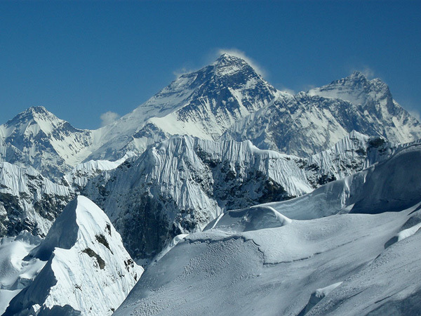 The stunning view east onto Everest and Lhotse from the West Ridge of Kang Nachugo, Himalaya, Joseph Puryear