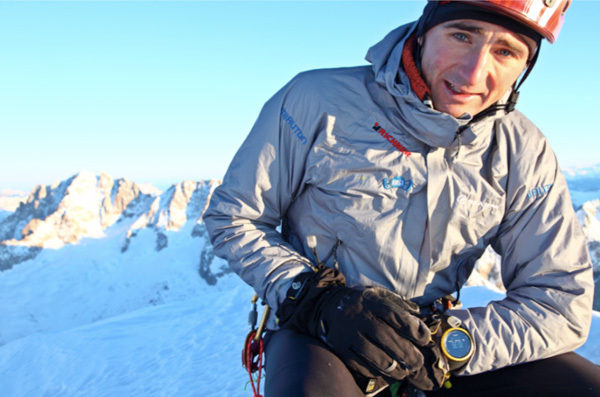 Ueli Steck on the summit of the Grandes Jorasses, Mont Blanc range, France after his record speed ascent of the MacIntyre Colton route., Ueli Steck