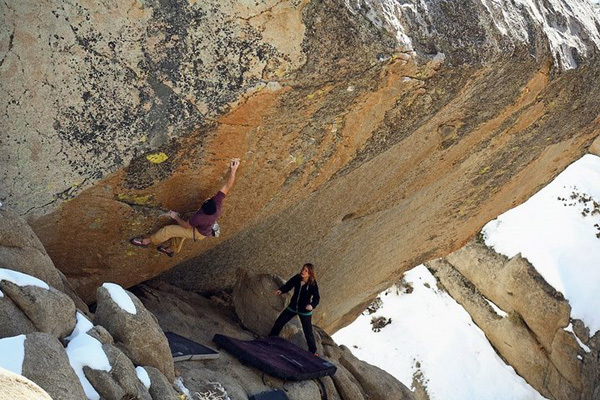 Shawn Young carrying out the first ascent of the highball Luminance V11, Bishop, California, USA, Wills Young