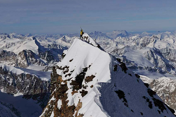 Ueli Steck on the summit of the Matterhorn after having climbed the Schmidt route in a record time of 1:56, Robert Bösch