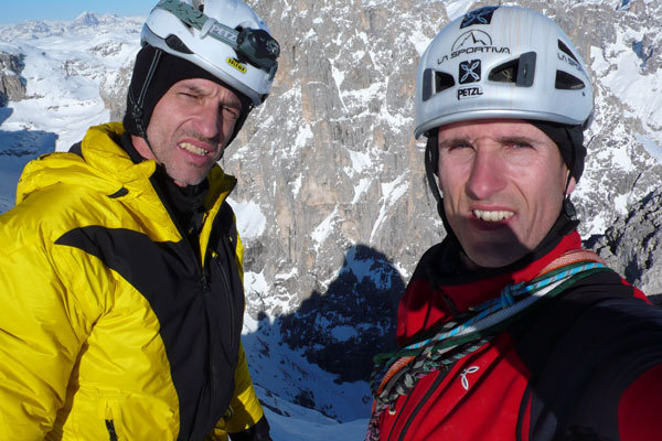 Fabio Leoni and Rolando Larcher on the summit, with the shadow of Sass Maor cast onto Cima Canali, arch. R. Larcher