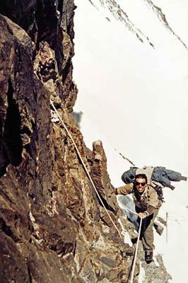 Achille Compagnoni negotiating the black rocks, located between camps 6 and 7 on K2 in 1954., arch. Lino Lacedelli