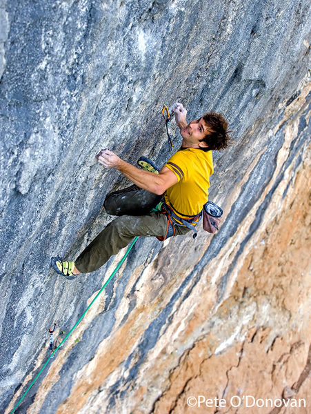 Chris Sharma during the first ascent of Pachamama 9a+ at Oliana, Spain., Pete O'Donovan
