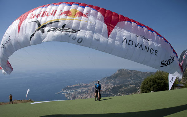 Christian Maurer prepares to take off from Mont Gros to Monaco and the finish to win the 2009 edition of the Red Bull X-Alps., Chris Hoerner/Red Bull Photofiles
