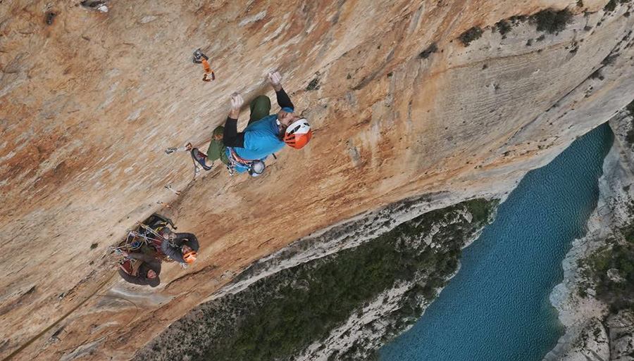 Chris Sharma and Klemen Bečan climbing at Mont-Rebei in Spain
