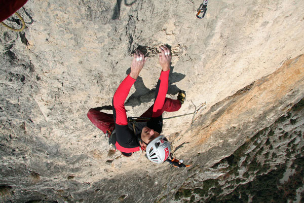 Rolando Larcher climbing the seventh pitch of Ultima Fiamma, Piccolo Dain, Valle del Sarca, Italy, arch Rolando Larcher