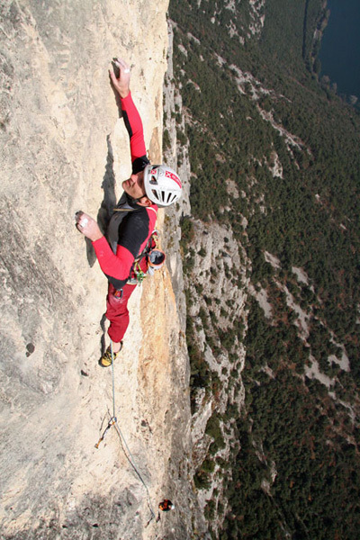 Rolando Larcher climbing the seventh pitch of Ultima Fiamma, Piccolo Dain, Valle del Sarca, Italy., arch Rolando Larcher