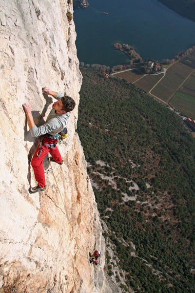 Geremia Vergoni climbing the 10th pitch of Ultima Fiamma, Piccolo Dain, Valle del Sarca, Italy, arch Rolando Larcher
