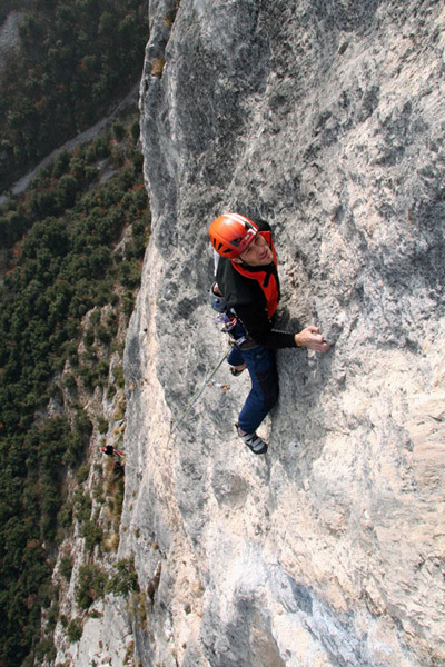 Tiziano Buccella climbing the 5th pitch of Ultima Fiamma, Piccolo Dain, Valle del Sarca, Italy, arch Rolando Larcher