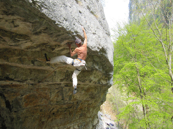 Riccardo Scarian making the first ascent of Shantaram 8c, Val Noana (Dolomites) , arch Scarian
