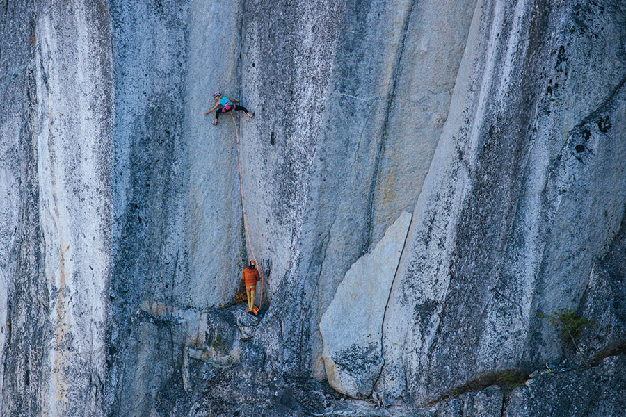 Katharina Saurwein, belayed by Jorg Verhoeven, climbing Tainted Love on The Chief above Squamish, Canada. The corner was first ascended in 2017 by Hazel Findlay Jessica Talley